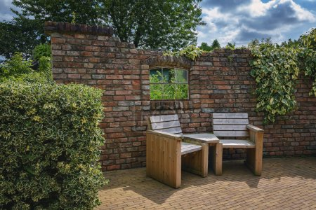 Garden furniture against the wall.