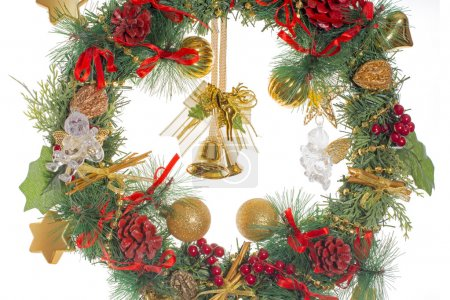 Christmas wreath with golden balls and cones and glass angels and bells and cherub