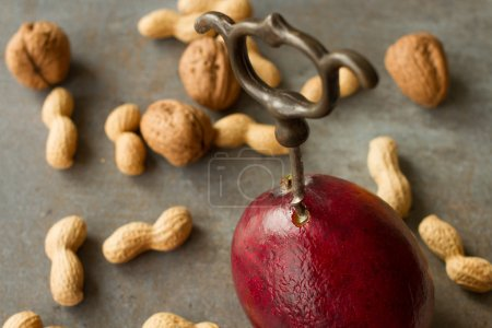 Juicy red mango. with corkscrew and nuts
