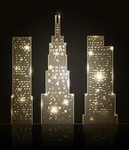 Three skyscrapers shining in dark