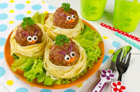 Photo for Funny spaghetti with meatballs for kids. Birds in nests - Royalty Free Image