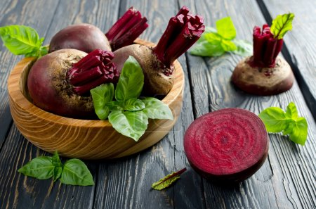 Young beets in a wooden bowl