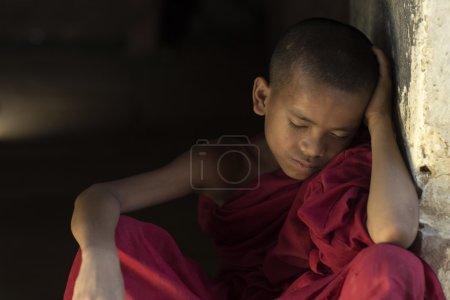 Photo for Burmese novice Sitting sleep in Buddhist temple - Royalty Free Image
