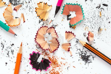 Photo for Creativity Concept Image of color Pencils and shaped wood Chips and Shavings of sharpening a pencil on white Table - Royalty Free Image