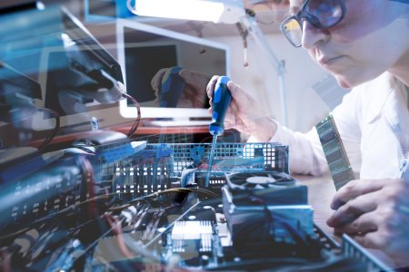 Photo for Throw the Window image of Computer Technician working with Hardware using tools in cold tones - Royalty Free Image