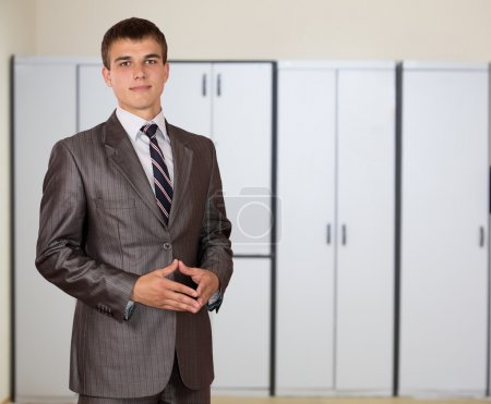 Representative young male businessman in the office