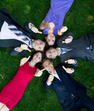 Group of happy business people on the grass