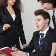 Three young businesspeople, one male and two femal...