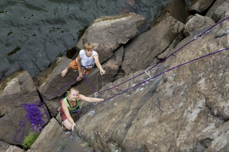 Climbing partners make ascent on to the rock wall