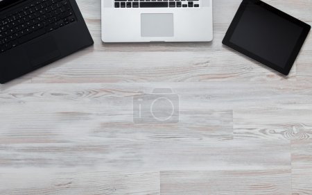 Wooden desk with many electronic devises