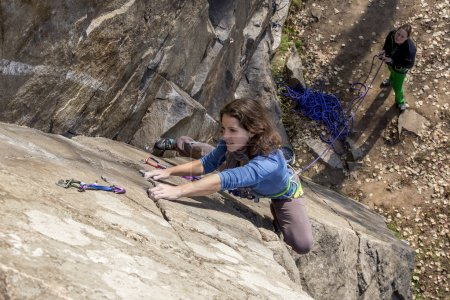 Pair of female climbers assault the rock wall