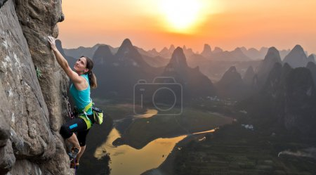 Silhouette of female athlete on Chinese mountain sunset