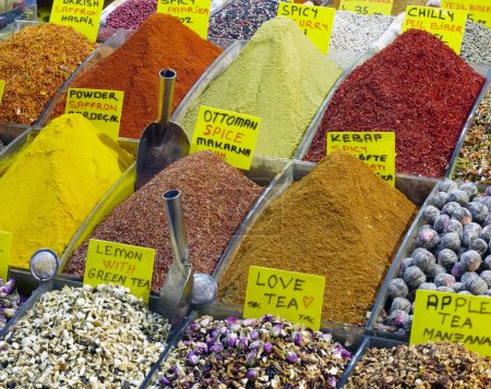 Photo for Image of selling point at Istanbul market with piles of colorful oriental spices and variety of tea - Royalty Free Image
