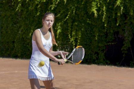 Female athlete returning ball