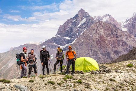 Alpine climbers team and camp
