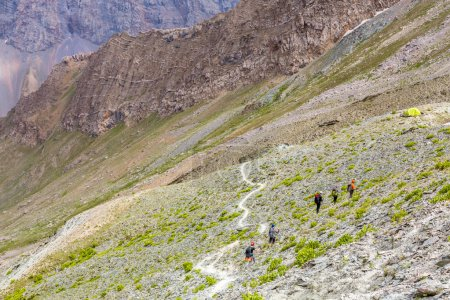 White mountain footpath and group of hikers