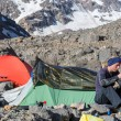 Mountain Expedition Camp Green and Red Tents Woman...