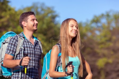 Excited Travelers Couple Young in Forest Inspired Faces