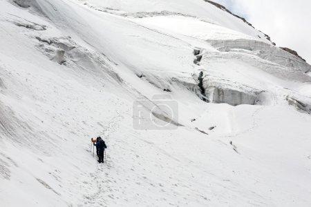 Alpine Partners Walking on Snow Trail