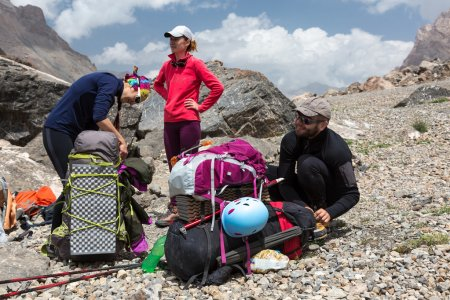 Hikers Packing Backpacks