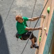 Aged Male Climber Moving Up on Outdoor Climbing Wa...