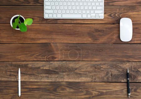 Brown Wooden Desk with Stationery and Electronics