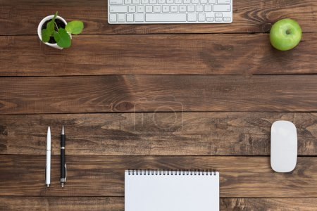 Brown Wooden Desk with Stationery Electronics Flora and Food