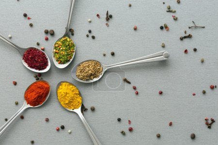 Close Up of Five Sorts of Asian Seasoning on Wooden Background