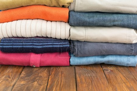 Jeans Pants and Classic Wool Sweaters on Wood
