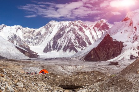 High Mountains Panorama with Red Tent on Glacier Moraine and Sun