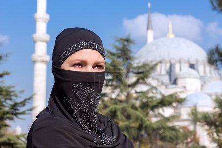 Portrait of beautiful Arabian Woman in traditional Muslim Clothing