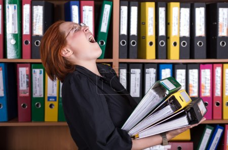 Business Lady holding large Stack of Office Folders