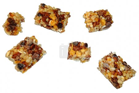 Segments of cereal bar isolated on white