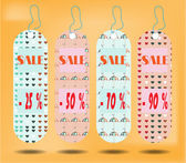 Three hanging tags with text Sale   tags made from pattern - hearts umbrellas