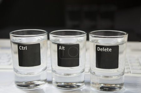 "Computer keyboard with ""Ctr-Alt-Delete"" command which pictured on the three glasses"