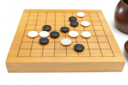 Photo for Goban, Baduk, Weiqi or Maklom - Traditional asian strategy board game. black and white stone of Chinese board game - Royalty Free Image