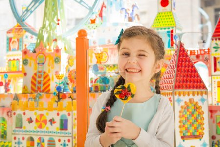 Beautiful hamming girl with lollipop in hands