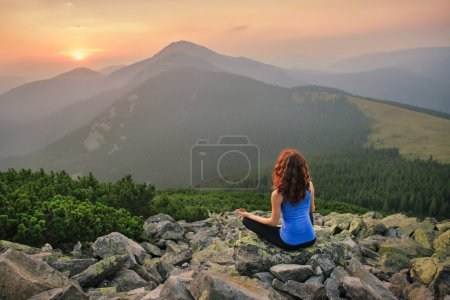 Photo for Woman feel freedom and enjoy the beautiful view in the mountains and looking on sunset - Royalty Free Image