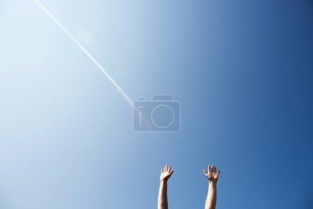 Man raise up hands in air