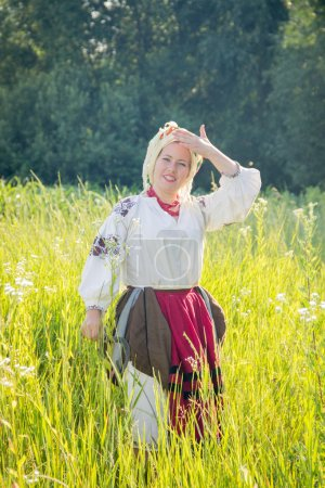 young girl, Ukrainian national costume, works in the fields, rea