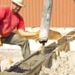 Постер, плакат: Male construction worker working on the construction of the foun