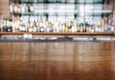Photo pour Top wooden table counter with Bar Blurred Background - image libre de droit