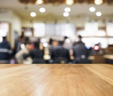 Foto de Table top counter with blurred Bar and people meeting Interior background - Imagen libre de derechos
