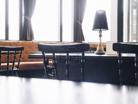 Photo pour Black Top of table and seating with Cafe Restaurant Interior background - image libre de droit