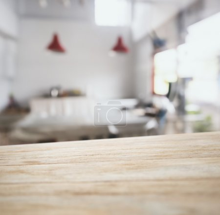 Photo for Table top counter bar with blurred kitchen interior background - Royalty Free Image