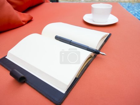 Open Blank Page Book on sofa with Coffee Cup