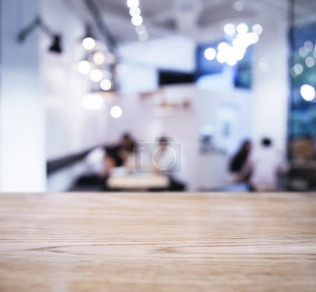 Table top with Blurred People Cafe Shop interior background