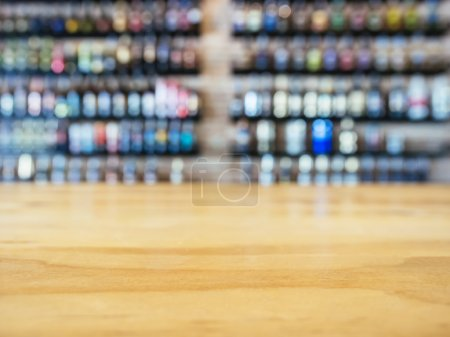 Table top Counter with Blurred Wine Liquor bottles Display