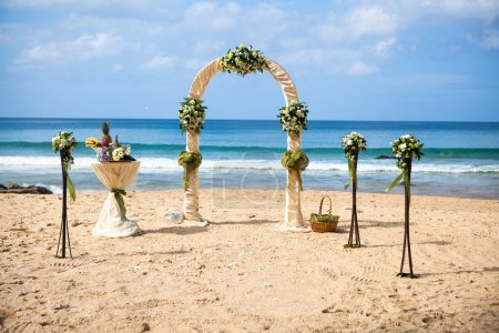 Wedding ceremony on the shore of the ocean sea arch on the beach