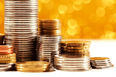 Coins stacks with golden bokeh background